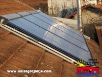 Solarno grejanje kuce i solarno grejanje sanitarne vode / Solarni vakuumski kolektori heat pipe / 120 vakuumskih cevi / Konstrukcija na kosom krovu